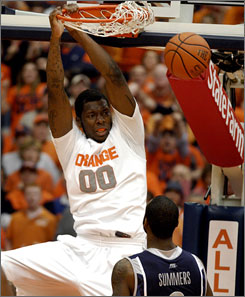 Syracuse's Rick Jackson slams through two of his 13 points in the Orange's win against Georgetown.