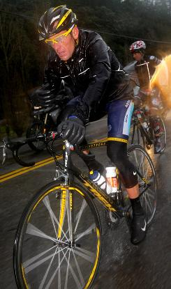 Lance Armstrong fought off the elements to finish amongst the leaders after Stage 1 of the Tour of California.