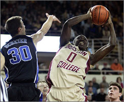 Boston College's Reggie Jackson, trying to get a shot over Duke's Jon Scheyer in the second half, gave the Eagles the lead for good after scoring a basket with 47.2 seconds left.