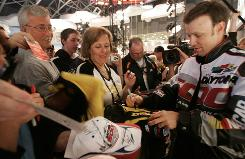 Daytona 500 winner     Matt Kenseth signs autographs for fans at the induction of his car into the Daytona 500 Experience at Daytona International Speedway.