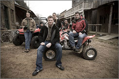 "Dale Earnhardt Jr., front, and his friends pose at his ranch in North Carolina, the set of his AMP Energy commercial ""Shotgun,"" that was shown during the Daytona 500."
