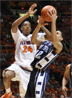 Penn State's Talor Battle pulls a rebound away from Illinois' Mike Davis during the second half of the lowest-scoring NCAA Division I game since Dec. 14, 2005.