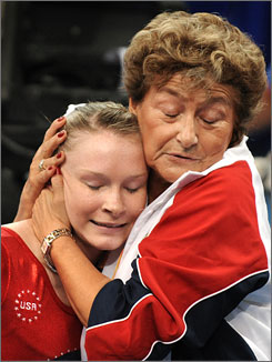Bridget Sloan gets a hug from U.S. national team coach Martha Karolyi after her uneven bars routine at the Beijing Olympics.