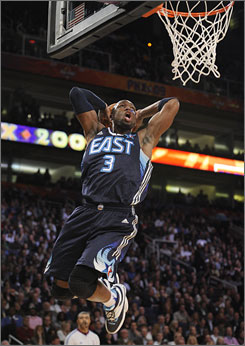 Dwyane Wade soars in for a dunk during the early stages of the NBA All-Star Game last Sunday.