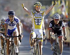 Great Britain's Mark Cavendish, center, celebrates as he wins stage five of the Tour of California cycling race. It was the second consecutive stage-win for Cavendish.