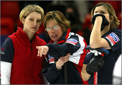 Erika Brown, left, skipper Patti Lank and Natalie Nicholson confer during the 2004 World Curling Championships. Brown will lead her own team at the U.S. Olympic trials this weekend.