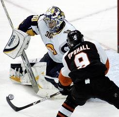 Flyers left wing Scottie Upshall takes a shot on Sabres netminder Ryan Miller en route to a 6-3 Flyers victory.