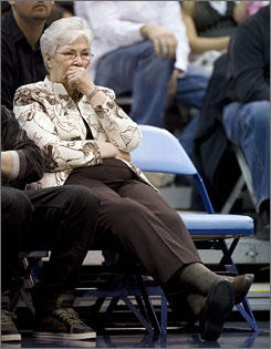 Gail Miller, widow of Utah Jazz owner Larry Miller, sits next to her husband's empty chair during Utah's game against New Orleans. Larry Miller, 64, died of complications from Type 2 diabetes Friday.