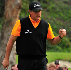 Phil Mickelson pumps his fist after sinking a birdie putt, one of four on the back nine, on the 16th hole during third-round play at the Northern Trust Open.