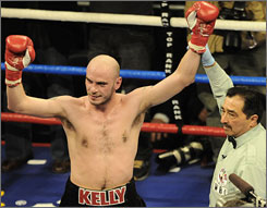 Referee Frank Garza raises Kelly Pavlik's arm in victory after the Youngstown, Ohio native stopped Marco Antonio Rubio after nine rounds before a hometown crowd.