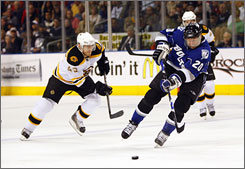 Tampa Bay Lightning center Vaclav Prospal (20) pushes the puck up the ice against the Boston Bruins during the second period. Prospal scored the game-winning goal with 1:33 left in the game.