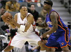 Raptors forward Shawn Marion looks for a lane to the hoop against Knicks defender Quentin Richardson during the first half.