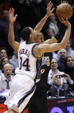 After bobbling the ball, Devin Harris chucked up a last-second, half-court shot to sink the Sixers 98-96.