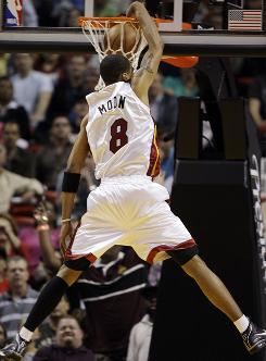 Heat forward       Jamario Moon dunks it against the Pistons, as Miami topped Detroit 103-91.