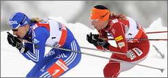 Kikkan Randall, right, chases Russia's Natalia Matveea in the sprint competition.
