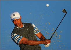 Tiger Woods, practicing Tuesday, returns to the PGA Tour this week after missing eight months after knee surgery.