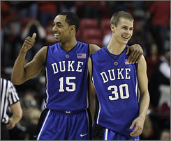 Duke's Gerald Henderson, left, and Jon Scheyer celebrate after the No. 7 Blue Devils defeated Maryland 78-67. Henderson scored 19 points and Scheyer added 12 for Duke.