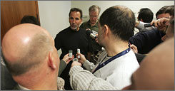Newly hired Rangers coach John Tortorella talks to reporters after his first practice.