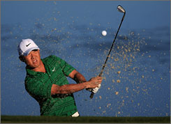 Anthony Kim hits his way out of trouble on the third hole Wednesday en route to winning his first match 7 and 5.