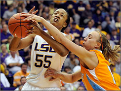 Tennessee forward Angie Bjorklund, right, fights for the ball with LSU forward LaSondra Barrett during the first half. Bjorklund led all scorers with 21 points, but Barrett had 18 to lead LSU to the 63-61 upset of the 23rd-ranked Lady Vols.