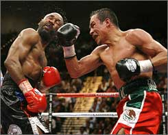 Juan Manuel Marquez, right, lands a shot against Joel Casamayor on his way to the linear lightweight championship in September.