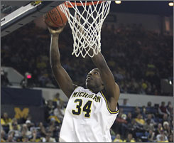 Michigan forward DeShawn Sims scores a layup against Purdue during the first half. Sims had a career-high 29 points as the Wolverines upset the 16th-ranked Boilermakers.