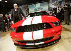 Carroll Shelby holds court after the introduction of the Ford Shelby Mustang Cobra GT500 at the 2005 New York International Auto Show.