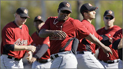 Miguel Tejada stretches during warm-ups at the Astros training camp.