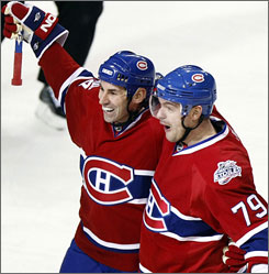 The Canadiens' Andrei Markov, right, celebrates his goal with teammate Mathieu Schneider during the first period against the Sharks. Montreal scored all three of its goals in a 6:42 span of the opening period.