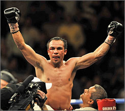 Juan Manuel Marquez lifts his arms in triumph after knocking out Juan Diaz in Houston.
