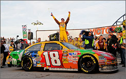 Kyle Busch celebrates after winning the Shelby 427 at Las Vegas Motor Speedway. Busch won the pole but had to start at the back of the pack due to an engine change.