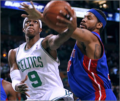 Detroit's Rasheed Wallace tries to stop Boston guard Rajon Rondo's drive in the first quarter.