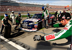 Dale Earnhardt Jr., pitting during Sunday's Shelby 427 in Las Vegas, says he'd be happy with another 10th-place finish this weekend.