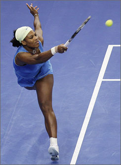 Serena Williams stretches to hit a running forehand to her sister Venus during the championship match of the Billie Jean King Cup. Serena beat Venus 6-4, 6-3.