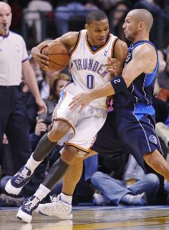 Oklahoma City guard    Russell Westbrook, left, led the Thunder to a 96-87 upset over the Dallas Mavericks. Westbrook, who recored the team's first triple-double of the season, spent the game matched up against trible-double ace    Jason Kidd, right.