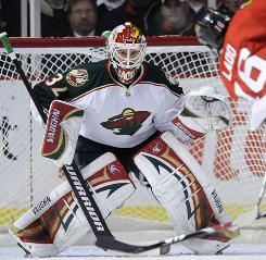 Minnesota Wild goalie   Niklas Backstrom braces himself to defend a shot against the Chicago Blackhawks on Jan. 19.