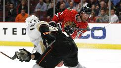 Martin Havlat of the Blackhawks scores the game-winning goal despite Anaheim's Corey Perry's best defensive efforts. The goal gave Chicago a 3-2 overtime win.