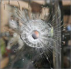 A bullet hole tells the story of Tuesday's attack on a bus carrying the Sri Lankan cricket team in Lahore, Pakistan. Seven players and their British assistant coach were wounded, authorities said.