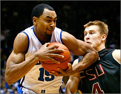 Duke's Gerald Henderson, drawing a foul from Florida State's Deividas Dulkys, scored nine of his 21 points in the final two minutes to help the victorious seventh-ranked Blue Devils.