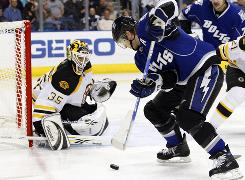 Tampa Bay Lightning Center Jeff Halpern takes a shot on Boston Bruins goalie Manny Fernandez last month. Halpern's leadership and faceoff skills might lead to a trade to a Stanley Cup contender.