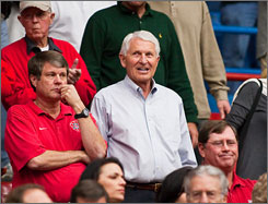 After 24 seasons walking the bench at the University of Arizona, Lute Olson now watches the Wildcats from his seat in the stands after retiring before the season. Olson is still helping the school, however, giving his insight on the hiring of a new coach.