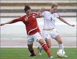 Lindsay Tarpley, right, battles for the ball with Denmark's Nadia Nadim.