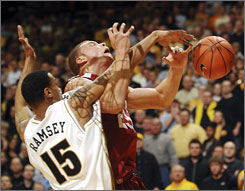 Missouri's Keith Ramsey fouls Oklahoma's Blake Griffin as the 12th-ranked Tigers secured a share of second place in the Big 12.