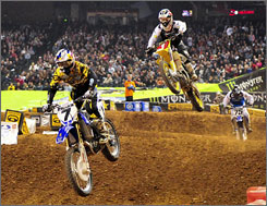 James Stewart leads an airborne Chad Reed during the Jan. 10 Phoenix event, which Stewart captured to begin his seven-race winning streak.
