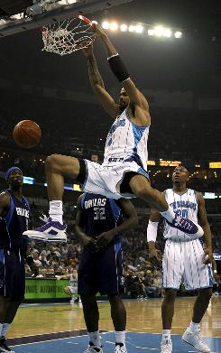 The Hornets' Tyson Chandler slams down a monster dunk against the Mavericks as New Orleans routed Dallas 104-88.