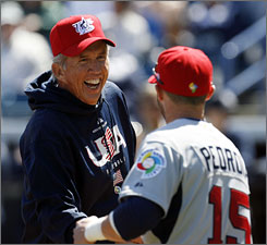 U.S. manager Davey Johnson, shaking hands with        Dustin Pedroia, thinks his players can go all the way.