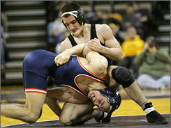 Iowa's Brent Metcalf, top, wrestling Bucknell's Kevin LeValley, is 68-1 the last two years.