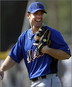 New York Mets third baseman David Wright sits two lockers down from National League East rival Jimmy Rollins of Philadelphia on team USA.