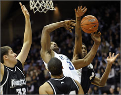 Villanova's Dante Cunningham, center, fights for a rebound against Providence's Marshon Brooks, right, and Randall Hanke, left, in the first half of Villanova's 97-80 win.