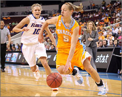 Tennessee Volunteers forward Angie Bjorklund, right, dribbles past Florida Gators guard Steffi Sorensen during their quarterfinal game in the SEC tournament. Bjorklund scored a game-high 25 points.